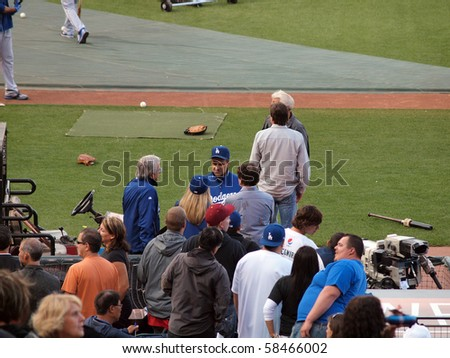 SAN FRANCISCO, CA - JULY 30: Dodger vs. Giants: Manager Joe Torre talks with people before the start of game.    July 30, 2010 Att Park in San Francisco CA.