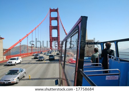 SAN FRANCISCO, CA - JUNE 13,  2008: Open double decker bus tour across the famous Golden Gate Bridge San Francisco CA.