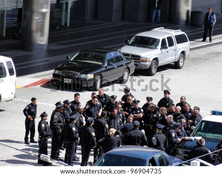 SAN FRANCISCO, CA - MAY 15:Group of Police Officers gather to discuss tactics outside by police cars on May 15, 2011 in San Francisco.