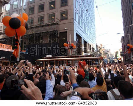 SAN FRANCISCO, CA - NOVEMBER 3: Giants fans celebrate the passing of trolleys during championship parade with fans waving and taking photos Nov. 3, 2010 San Francisco, CA.