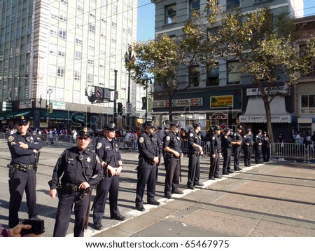 SAN FRANCISCO, CA - NOVEMBER 3: Police officers stand in line across market street keeping the peace after Giants World Series Parade Nov. 3, 2010 San Francisco, CA.
