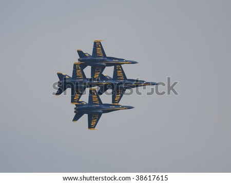 SAN FRANCISCO, CA. - OCTOBER 10: Blue Angels flying in a tightly grouped formation over the bay area during Fleet Week on October 10th 2009 in San Francisco, CA.