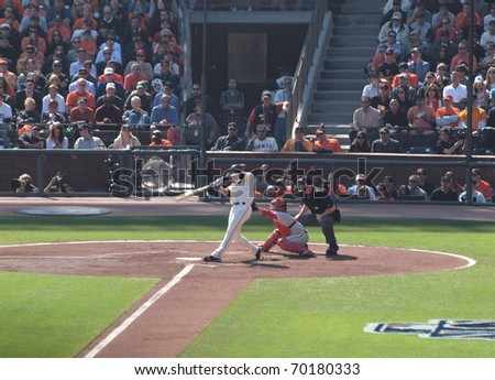 SAN FRANCISCO, CA - OCTOBER 19: Giants vs. Phillies: Buster Posey swings at pitch as catcher reaches for ball game three of the NLCS 2010 taken October 19, 2010 AT&T Park San Francisco Ca