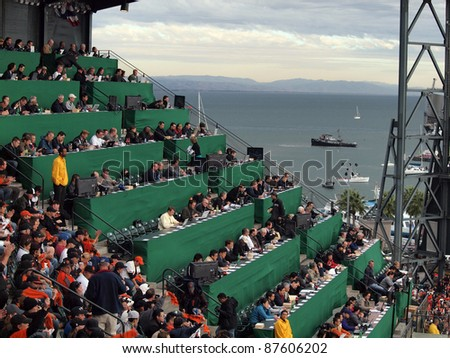SAN FRANCISCO, CA - OCTOBER 28: Overflow Media watches baseball game in the upperdeck with view of water during game 2 of the 2010 World Series game at AT&T Park on Oct. 28, 2010 in San Francisco, CA.