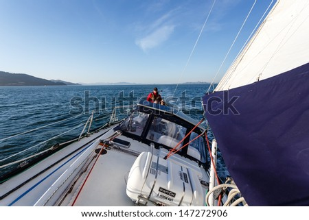 SAN FRANCISCO, CALIFORNIA - FEBRUARY 16, 2013: View of sailboat cockpit and helmsman from bow in the Bay on February 16, 2013. San Francisco is the currently hosting the 2013 Americas Cup races.