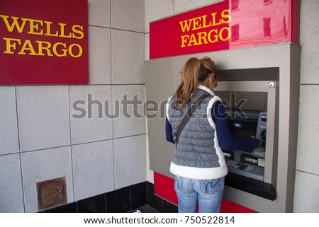 San Francisco, California - November 6th, 2017; A woman is using the Wells Fargo ATM