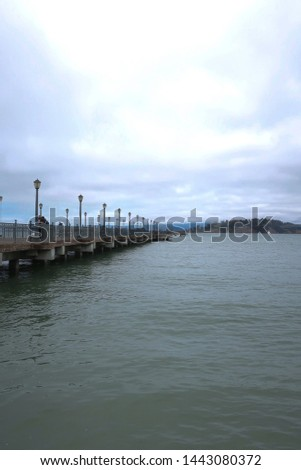 SAN FRANCISCO/CALIFORNIA/UNITED STATES-05/18/19: San Francisco Ferry Plaza Pier Looking out toward the East Bay on a cloudy morning  #1443080372