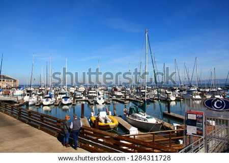 San Francisco, California, US-17 February 2015:Numerous boats docked at Pier 39 Marina. Pier 39 Marina features 300 boat slips and provides guest docking and slip rental.  #1284311728