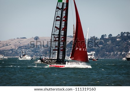 SAN FRANCISCO, CALIFORNIA, USA - AUGUST 25, 2012: Italian Team Prada racing in Louis Vuitton Cup part of the America's Cup World Series on August 25, 2012 in San Francisco Bay, California