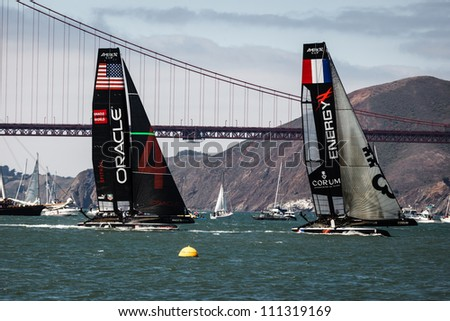 SAN FRANCISCO, CALIFORNIA, USA - AUGUST 25, 2012: Team Oracle USA, French Team Energy race in Louis Vuitton Cup part of America's Cup World Series on August 25, 2012 in San Francisco Bay, California