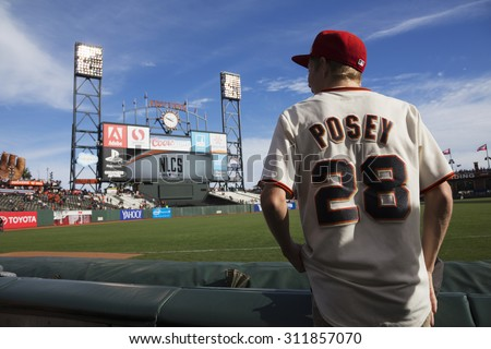 San Francisco, California, USA, October 16, 2014, AT&T Park, baseball stadium, SF Giants versus St. Louis Cardinals, National League Championship Series (NLCS), fan with Posey #28 uniform pre-game