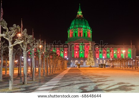 San Francisco city hall illuminated in Christmas colors.