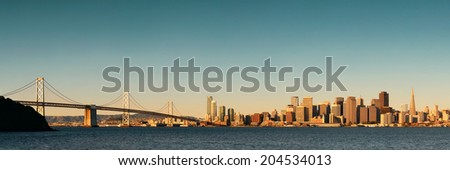 San Francisco city skyline panorama with urban architectures at sunrise.