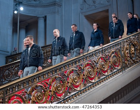 SAN FRANCISCO - FEB 20: The crew for BMW Oracle, winners of the 33rd America's cup, walk down the red carpet at City Hall on Feb 20, 2010 in San Francisco