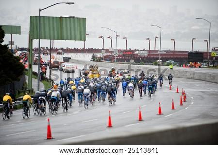 SAN FRANCISCO - FEBRUARY 16: Tour de California participants bicycle race across the Goldengate Bridge in San Francisco, California on Feb. 16,, 2009.