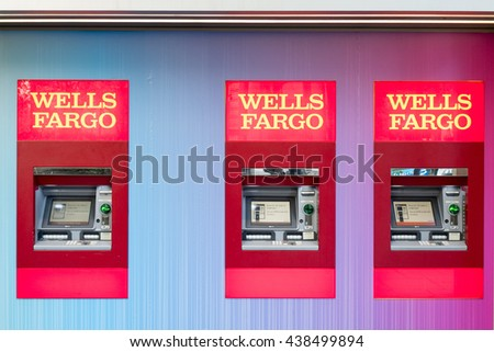 San Francisco - Jun 13th, 2016: Three Wells Fargo atm. Wells Fargo is a provider of banking, mortgage, investing, credit card, insurance, and consumer and commercial financial services.