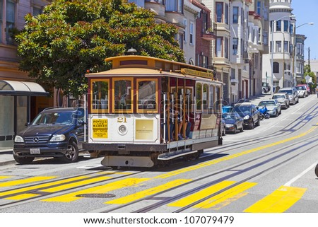 SAN FRANCISCO - JUNE 20: Famous Cable Car Bus near Fisherman's Wharf on June 20, 2012 in San Francisco, California. Cable car trains first began operating in the city in 1873.