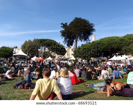 SAN FRANCISCO - JUNE 14:  People sitting around watching the North Beach Festival Concert on stage Washington Park taken June 14, 2009 San Francisco, CA