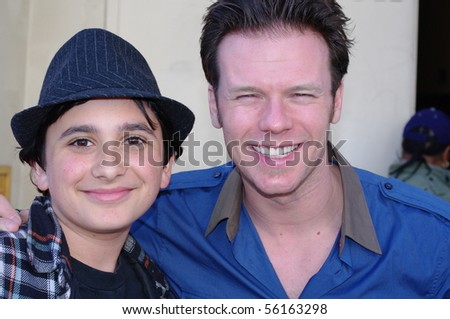 SAN FRANCISCO-MARCH 23: Broadway musical actor Nicolas Dromard (right) greets fan Joseph Weinberg  at the stage door of Wicked at the Orpheum Theater March 23, 2010 in San Francisco, California