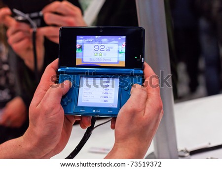 SAN FRANCISCO - MARCH 2: Nintendo showing its new portable device, the Nintendo 3ds at GDC 2011 event in San Francisco on 2nd March 2011