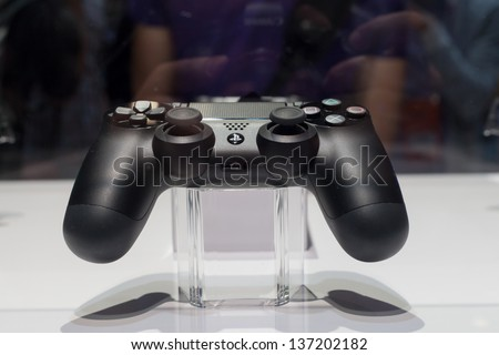 SAN FRANCISCO - MARCH 27: Sony unveiling its new dualshock 4 controller for PlayStation 4 at GDC 2013 event in San Francisco on 27th March 2013 - stock photo
