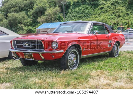 SAN FRANCISCO - MAY 27: A 1967 Ford Mustang is on display during the Golden Gate Bridge 75th Anniversary in San Francisco on May 27, 2012