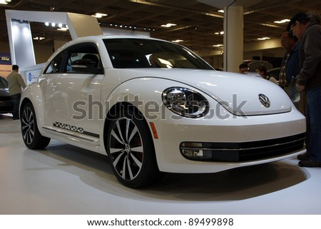 SAN FRANCISCO - NOVEMBER 21: A Volkswagen New Beetle is on display during the 2011 International Auto Show at the Moscone Center in San Francisco on November 21, 2011