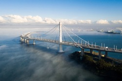 San Francisco - Oakland Bay Bridge Above Layer or Low Fog