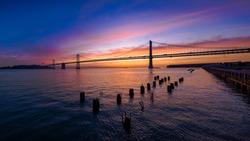 San Francisco-Oakland Bay Bridge at Sunrise with Colorful Clouds, California, USA