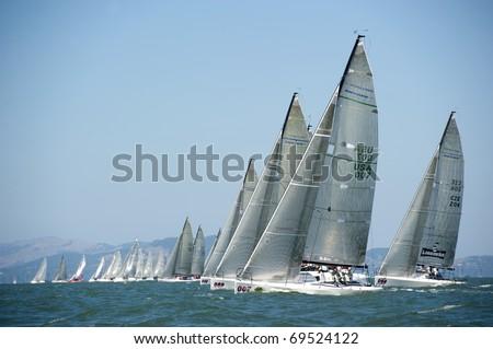SAN FRANCISCO - SEPT 23: Melges 32 World Championship, Sept 23, 2010, San Francisco bay. Q, sail #007, pulling ahead at the start of race 1.