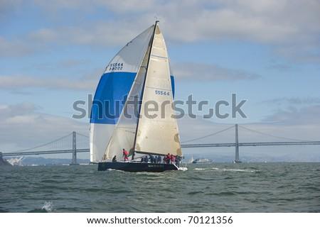 SAN FRANCISCO - SEPT 18: rolex big boat race 6, sept 18, 2010, San Fransisco. wasabi, winner of the irc c division flying their spinnaker along san francisco bay bridge.