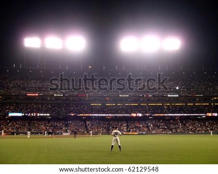 SAN FRANCISCO - SEPTEMBER 29: Diamondbacks vs. San Francisco Giants:   Giants Outfielder Nate Schierholtz looks over before start of inning.  Taken September 29 2010 at  ATT Park in San Francisco.