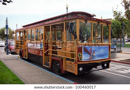 SAN FRANCISCO - SEPTEMBER 20: Famous Cable Car Bus near Fisherman's Wharf on September 20, 2007 in San Francisco, California. Cable car trains first began operating in the city in 1873.