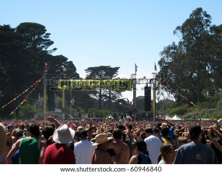 SAN FRANCISCO - SEPTEMBER 11: People wave hands in the air as Rebelution Plays at Power to the Peaceful 2010 Music Festival.  Taken September 11, 2010 at Golden Gate Park San Francisco.