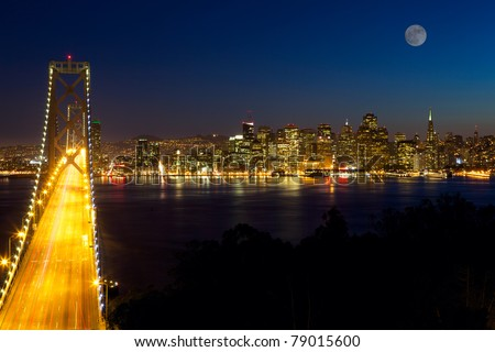 San Francisco skyline and Bay Bridge at night, California, USA