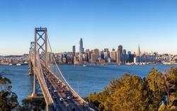 San Francisco skyline and Bay Bridge at sunrise, California