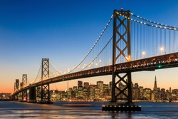 San Francisco skyline and Bay Bridge at sunset, California USA