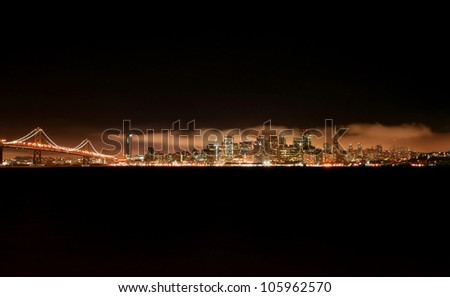San Francisco skyline at night from treasure island with bay bridge on the left