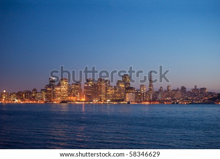 san francisco skyline including the transamerica pyramid and the ferry building waterfront