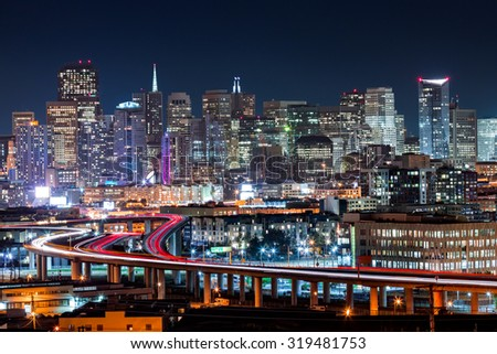 San Francisco skyline with rush hour traffic on the winding highways
