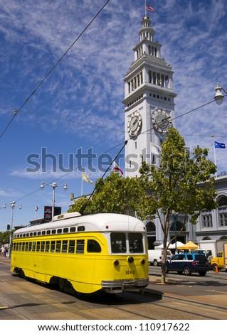 San Francisco Trolley Car moves through the street in California