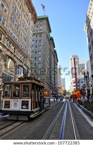 SAN FRANCISCO, USA - AUGUST 15:  tourists on a cable car on August 15, 2011 in Francisco. Cable cars in San Francisco are in service since 1873 and carry 10 million passengers per year
