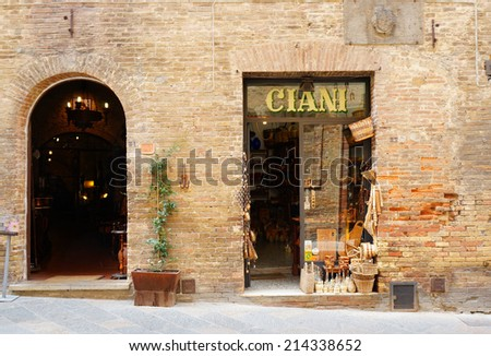 SAN GIMIGNANO, ITALY - AUGUST 20, 2014: Entrance of an wine store in the city center