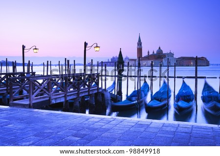 San Giorgio Maggiore church and gondolas at dawn in Venice - Italy