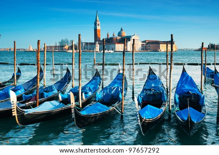 San Giorgio Maggiore church and gondolas in Venice - Italy - stock photo