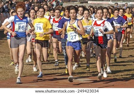 SAN GIORGIO SU LEGNANO-ITALY-FEBRUARY 15, 2005:youth  female runners start at the cross country run race Campaccio, in San Giorgio su Legnano.