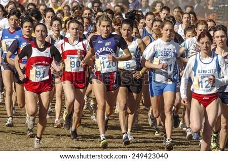 SAN GIORGIO SU LEGNANO-ITALY-FEBRUARY 15, 2005: youth female runners start at the cross country run race Campaccio, in San Giorgio su Legnano.