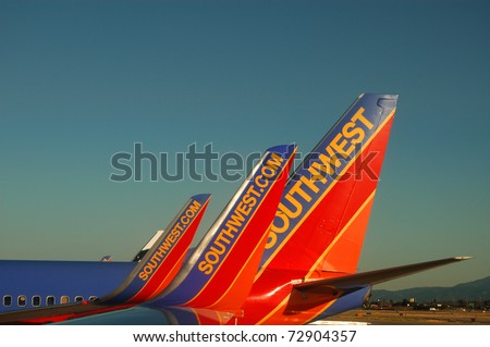 SAN JOSE, CA - JULY 29: Southwest Airlines aircraft at San Jose International Airport, July 29, 2010. Airlines have been raising ticket prices in response to rising fuel costs.