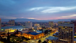 San Jose, Silicon Valley, view of downtown, the Tech Museum, McEnery Convention Center, Silicon Valley, and the Santa Cruz Mountains at sunset.