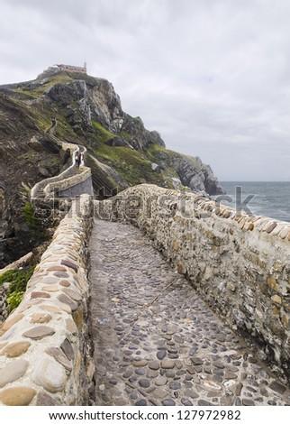 San Juan de Gaztelugatxe. The photo shows the stone bridge leading to the chapel